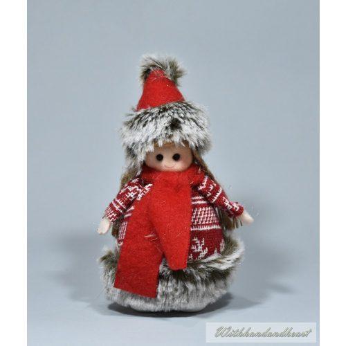 Gyerek kötött pulcsiban, karácsonyi dekoráció